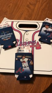 A picture of a Braves foam cushion and 3 koozies.