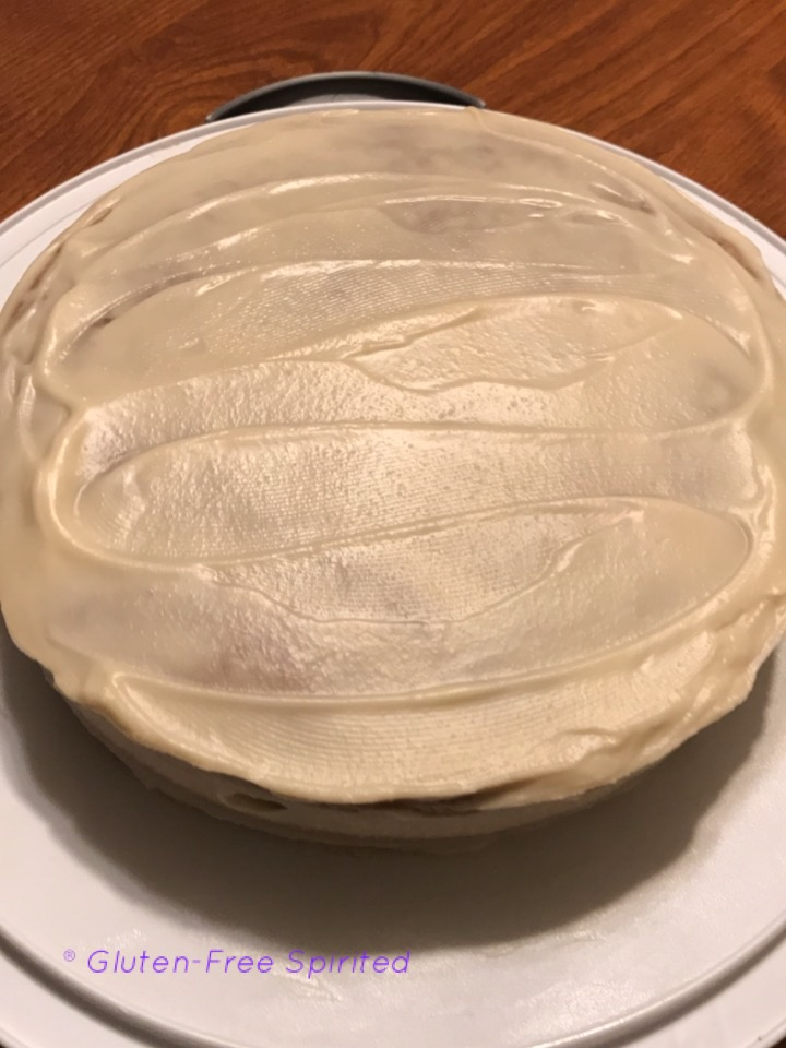 A picture of cake after sitting in the fridge for 10 minutes to let frosting set.