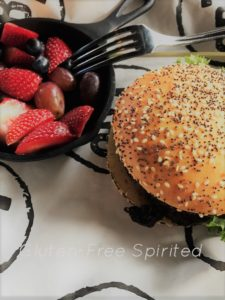 Hamburger with gluten-free bun and a side of fruit