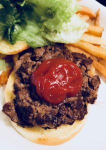 hamburger with lettuce and ketchup