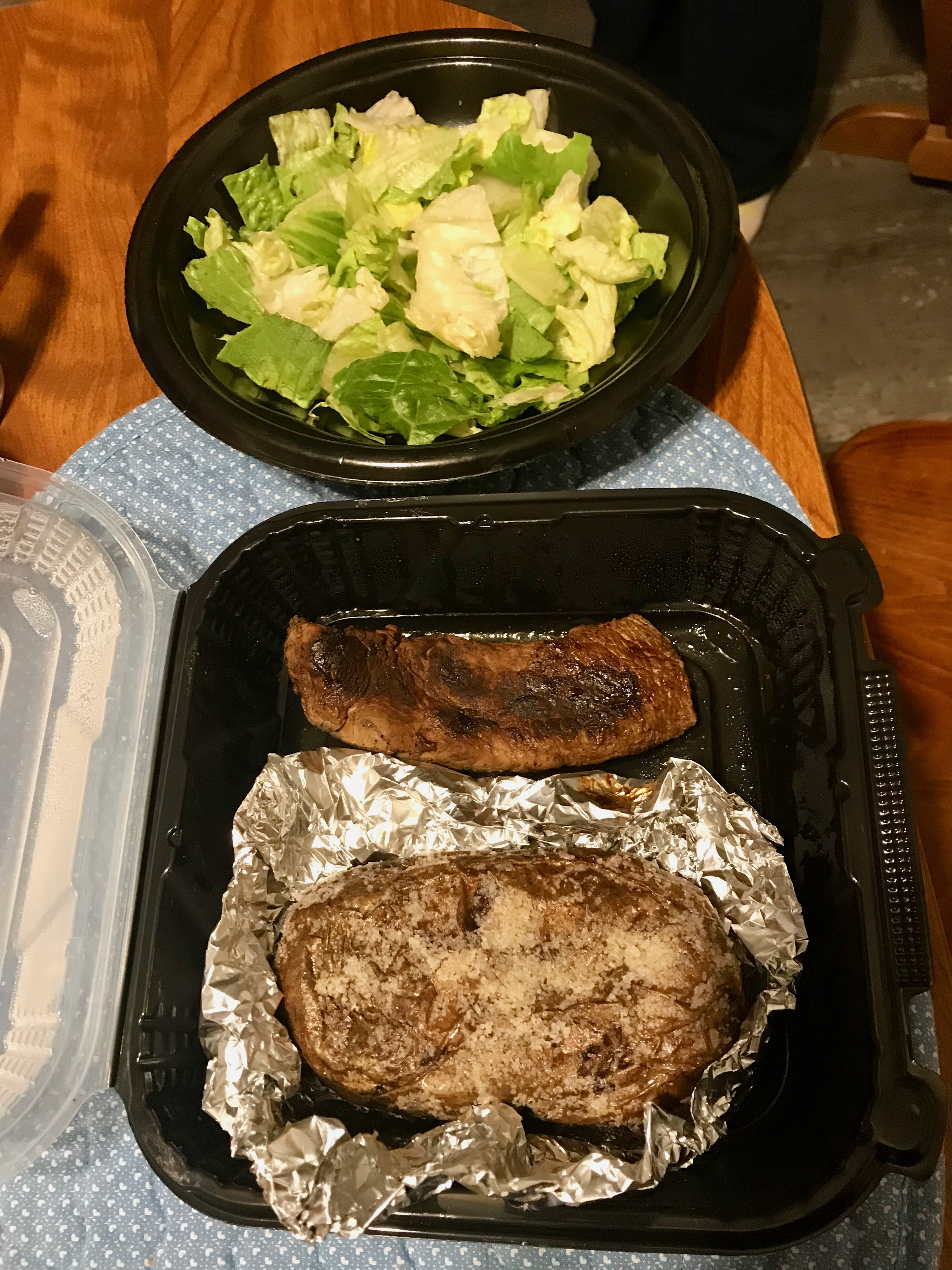 Outback steak, baked potato, & salad